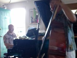 Scot Ranney and Andy Simmons jazz piano and bass duo at a house party