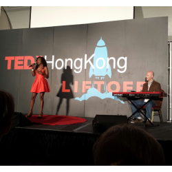Scot Ranney playing with Sybil Thomas at TedX in Hong Kong